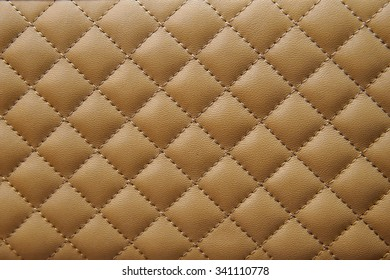 Beige and Brown leather background with stitching