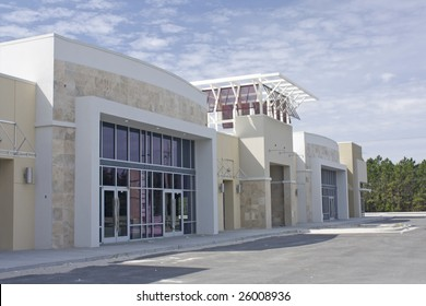beige, brown and white strip mall with stone accents