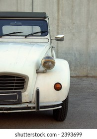 A beige Citroen 2cv from the 80's, partial frontal view
