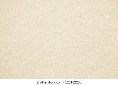 beige colored house front, structured with spatula techniques, background design