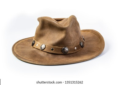 beige cowboy hat, decorated of five cents coins isolated on a white background