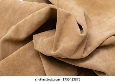Beige dyed soft nubuck folded cow leather.
