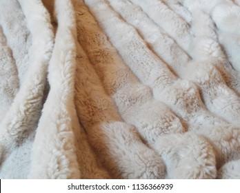 Beige faux fur blanket