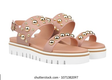 Beige female sandals with platform and decorations. Stylish spring summer shoes isolated on white background