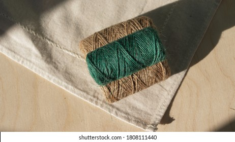 beige and green skeins of twine for eco gift wrapping