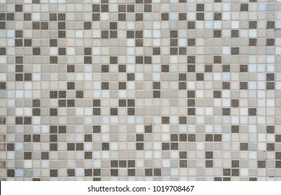 Beige and grey mosaic tiles. Mosaic background.