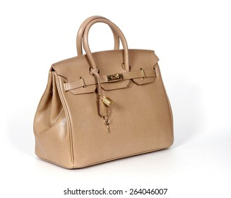 Beige handbag from genuine leather isolated on white background