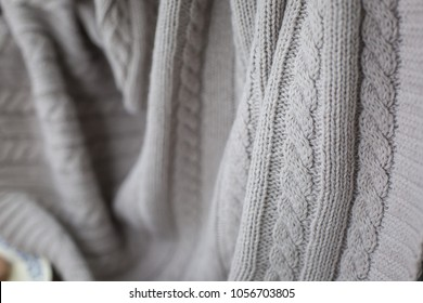 beige knitted blanket close up e517858a1