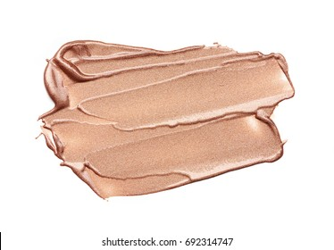 Beige or light brown smear of lip gloss isolated on a white background. Texture of light beige smear of lip gloss isolated on a white background