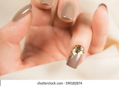 Beige manicure.