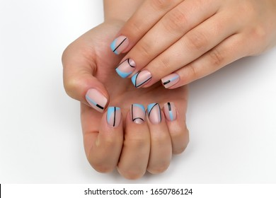 beige manicure with black and blue stripes, circles, abstraction on square nails. Oblique french manicure.