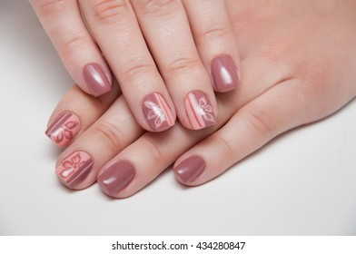 beige manicure on a white background with short nails with flowers