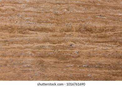 Beige marble travertine texture, close up. High resolution photo.