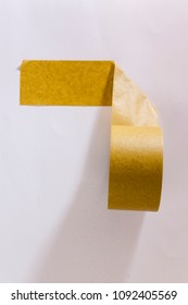 Beige masking tape on a white wall