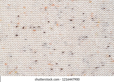 Beige melange fabric knitted texture background. Cotton jersey. Purl, reverse loop