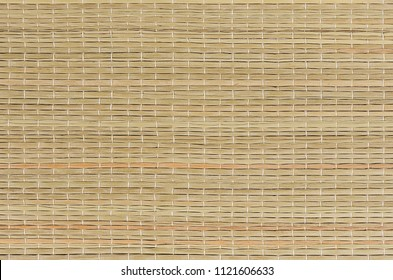 Beige natural mat of dry wicker grass as texture, background.