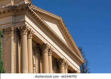 Beige neoclassic style building with detailed architecture columns