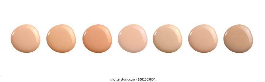 Beige nude liquid foundation set, concealer smear smudge drop. Collection different tones bb cream swatch sample isolated on white. Cosmetic liquid foundation, concealer or moisturizer. Macro, banner