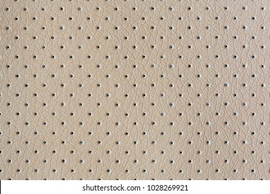 Beige perforated eco leather with embossed closeup