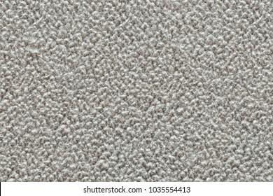 Beige polar fleece fabric texture close up as background