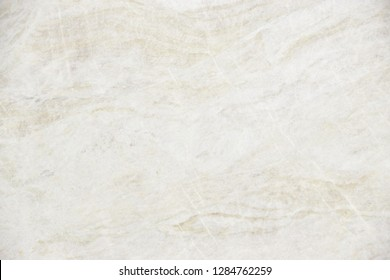 Beige quartzite stone with natural pattern texture background.
