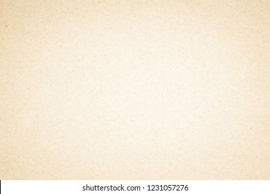 Beige recycled craft paper texture as background. Brown paper texture, Old vintage page or grunge vignette. Hardboard with copy space.