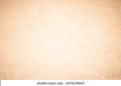 Beige recycled craft paper texture as background. Brown paper texture, Old vintage page or grunge vignette wrapping paper. Design brown retro for interior decoration hardboard with copy space.