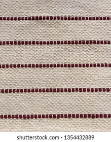 Beige rough canvas with dark red cotton ropes decoration texture background