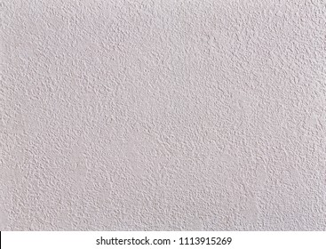 Beige rough wall textured background. Abstact stucco. Texture of plaster on the wall.