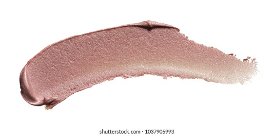 Beige smears of crushed highlighter or luminizer isolated on white background. Makeup smear of creamy lipstic isolated on white background. Creamy lip gloss texture isolated on white background