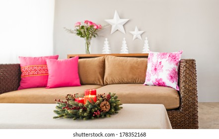 Beige sofa with colourful pillows in simple setting