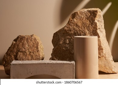 Beige stone and a piece of grey podium tile on a beige background, natural background with shadow of tropical plant for your product - Shutterstock ID 1860706567