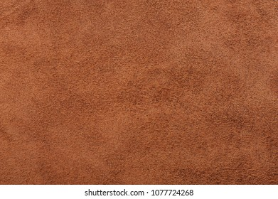 Beige suede soft leather as texture background.