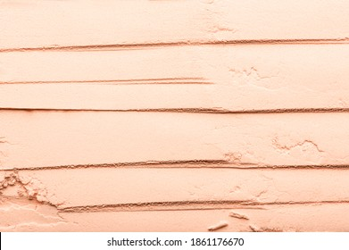 Beige texture of scattered, broken powder close-up. Nude powdery tonal beauty makeup. Abstract cosmetic textured background of blush, concealer, corrector for perfect complexion