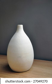 Beige vase in ceramic used as room decoration.