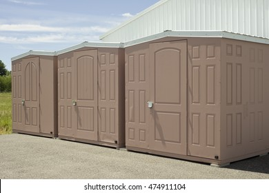 Beige and white outdoor self storage unit sheds.