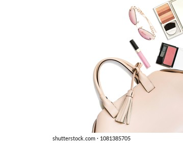 Beige woman's handbag and accessories isolared on white background, copy space