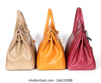 Beige yellow purple genuine leather bags isolated on white background