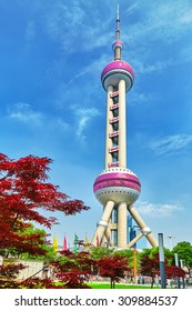 BEIGING, CHINA- MAY 24, 2015: Oriental Pearl Tower on  blue sky background. Tower 470 meter the Oriental Pearl is one of Shanghai's tallest buildings.