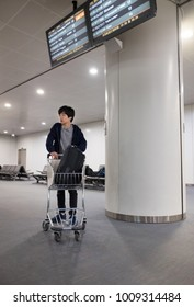 BEIJING - 28 DEC: Young Chinese man waiting in Terminal 3 of Beijing airport on 28 December 2017 in Beijing, China. Terminal 3 is the second largest airport terminal in the world by area.