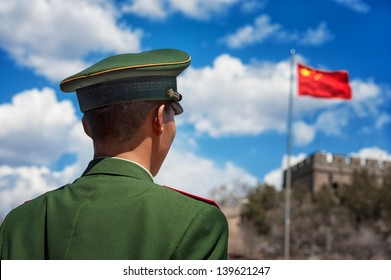 BEIJING - APRIL 24: Soldier stands guard near the Great Wall of China during a high profile visit by a French government delegation on April 24, 2013 in Beijing, China.