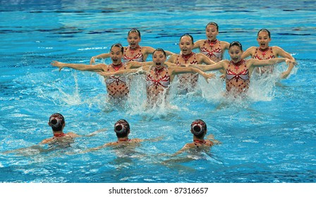 BEIJING - APRIL 24: Beijing Water Cube team of China competes in the group A Free Combination Final during the China Synchronised Swimming Open 2011 on Apr 24, 2011 in Beijing, China.