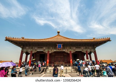 Beijing - April 25, 2015: The Palace Museum under the background of blue sky and white clouds gathers a lot of visitors.