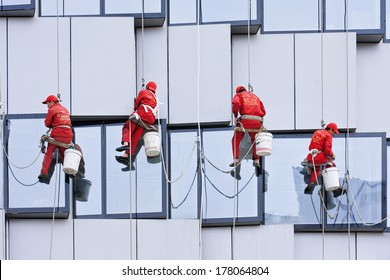 BEIJING - APRIL 28, 2009. Window cleaners at work. They are known as 'spider-men'� because they often entrust their lives to a single thread, made of hemp and nylon thick as a gearstick.