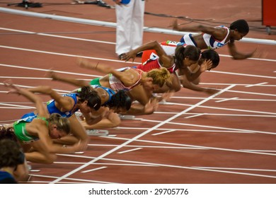 BEIJING - AUG 18: Athletes take off as the women's 100 meter sprint begins at the Summer Olympic Games.  Birds Nest Stadium August 18, 2008 Beijing, China