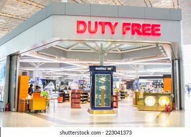 BEIJING - AUGUST 30:  Duty free shop at Beijing Capital Airport on August 30, 2014. The world's largest airport terminal-building complex measures 986,000 m2 floor surface.