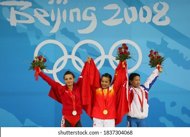 BEIJING - AUGUST 9: 2008 in the Beijing Olympic Games (LR) Silver medalist Sibel Ozkan, Turkey, China Chen Xiexie gold medal, the bronze medal China Chen Wei-Ling Women's 48kg medal ceremony.