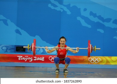BEIJING - AUGUST 9: 2008 Beijing Olympics in the women's 48 kilos in weight and winning silver medal in weightlifting competitions Sibel Ozkan of Turkey while lifting dumbbells.