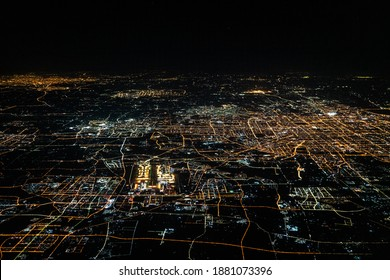 Beijing, capital of China, aerial view during night time, including Beijing Capital International Airport and streets are illuminated