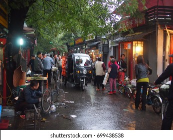 Beijing, China - 07 October, 2016: A food market in an old Beijing hutong in the rain